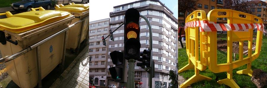 fotos del color amarillo en el ambiente urbano: cubos de reciclado con tapa amarilla, semáforo en ambar y valla amarilla